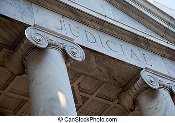 A judicial courthouse with two pillars
