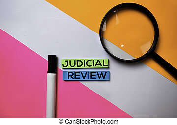 Judicial Review text on sticky notes with color office desk concept