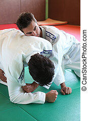 Judo hold down.