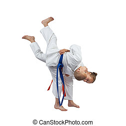 Judo throw in perfoming sportswoman with an orange belt