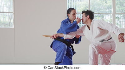 Judoka dodging the attack of his opponent