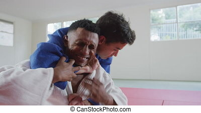Judoka strangling his opponent on the judo mat - High angle ...