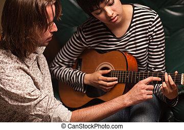 juego, estudiante, músico, joven, guitarra, hembra, enseña