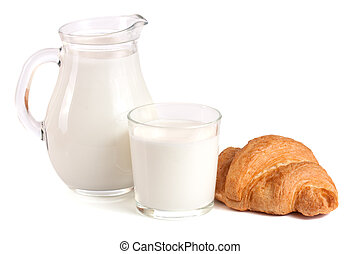 Jug and glass of milk with croissant isolated on white background