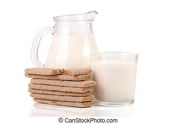 jug and glass of milk with grain crispbreads isolated on white background