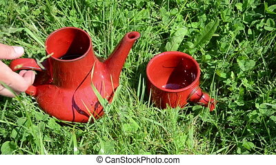 jug cup meadow - water is leaking from red clay nice jug...