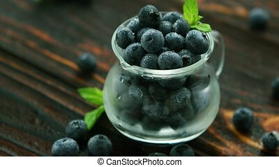 Jug full of blueberry with green leaf - Closeup blueberry...