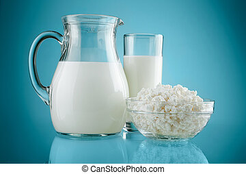 jug glass with milk and curds on blue background