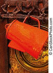 Jug hanging on the walls orange vintage style.