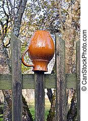 jug on the village fence