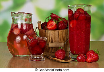 Jug with drink and strawberry in a bucket