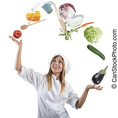Juggler chef play with some ingredients and kitchen tools