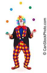 Juggler clown throwing colorful balls