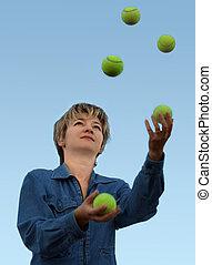 Juggler - Woman juggling with tennis balls