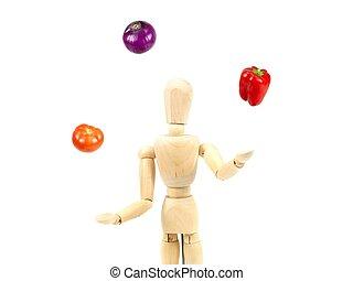 Juggling Health - A wooden mannequin juggling vegetables ...