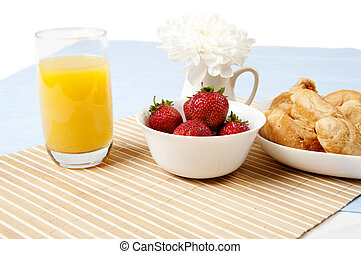 juice, croissants and Berries On a bamboo