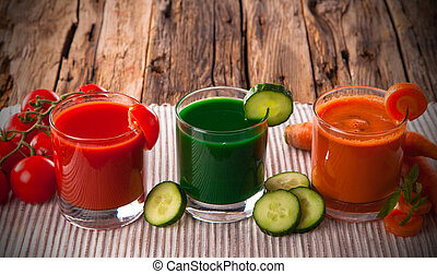 Fresh vegetable juices on wood plant, cucumber, tomato and carrot drinks