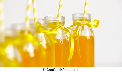 juice or lemonade in glass bottles with straws - drinks and...