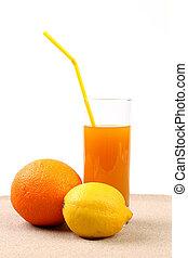 Juice, orange, lime on sand. White background.