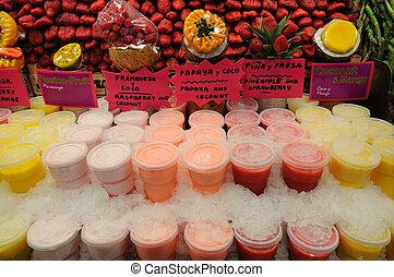 Juice stand at market La Boqueria in Barcelona Spain