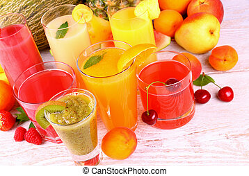 Juice with kiwi, apricot, cherry, melon an white wood