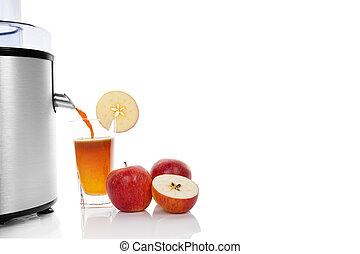 Juicing fresh apples.