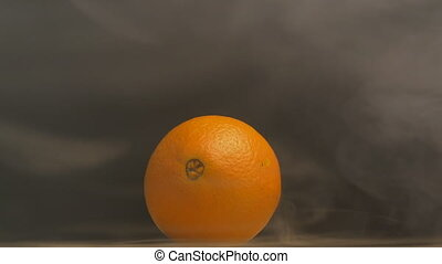 Juicy and ripe orange fruit from which evaporation and...