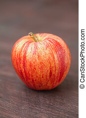 juicy apple on a wooden surface