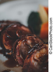 Juicy bacon wrapped pork