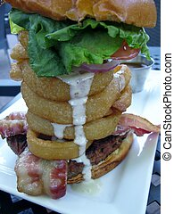 Juicy beef, bacon and onion rings burger tower