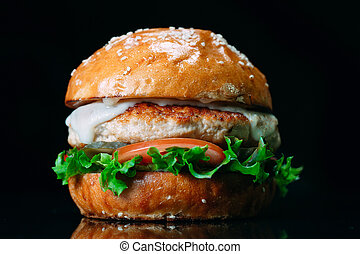 Juicy beef Burger on a black background.