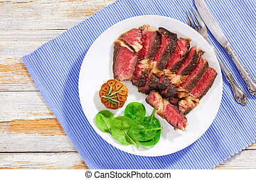 Juicy beef steak medium rare  with spices