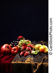 Juicy bright fruit, sprinkled with water, still life of seasonal fruits and berries, copyspace
