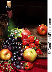 Juicy bright fruit, sprinkled with water, still life of seasonal fruits and berries, copyspace, Classic Dutch still life