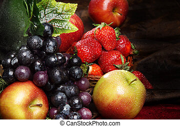 Juicy bright fruit, sprinkled with water, still life of seasonal fruits and berries