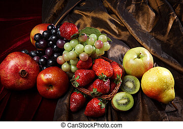 Juicy bright fruit, sprinkled with water, still life of seasonal fruits and berries, top view