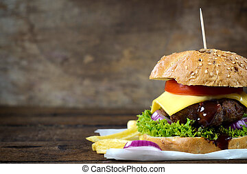Juicy cheeseburger - Juicy cheesburger on the wooden...