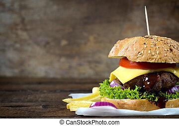 Juicy cheeseburger - Juicy cheesburger on the wooden...