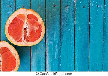 Juicy citrus grapefruit on a blue background