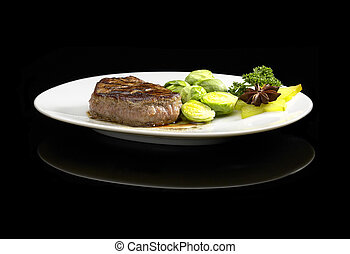 filet mignon - juicy filet mignon on plate with brussel...