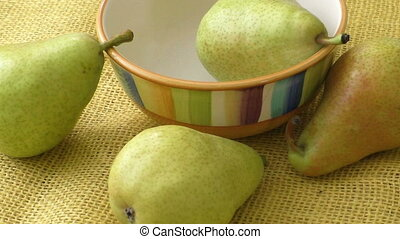 Juicy flavorful pears of nature background. Fresh organic pears on yellow sacking.