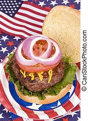 Juicy fourth of July hamburger - A juicy hamburger with...