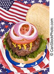 Juicy fourth of July hamburger - A juicy hamburger with...