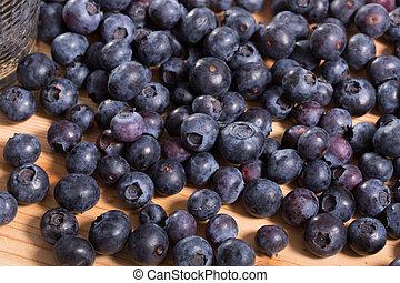 Juicy fresh blueberries on wooden table