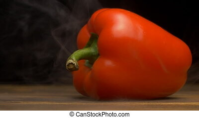 Juicy fresh Bulgarian red pepper on a black background,...