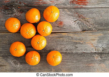 Juicy fresh clementines on a rustic wooden table