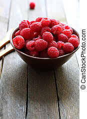 juicy fresh raspberries in a bowl