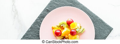 juicy fruit salad for breakfast on marble, flatlay - dieting and healthy lifestyle concept