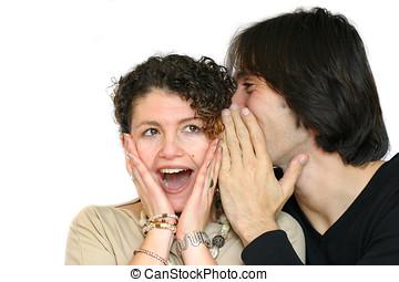 Juicy gossip - Man whispering some juicy gossip into his...