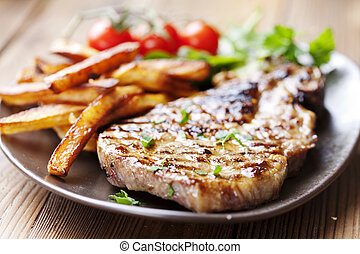 pork chop - juicy grilled pork chop (neck cut) with greens